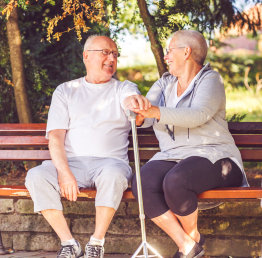 senior couple in a bench outdoors