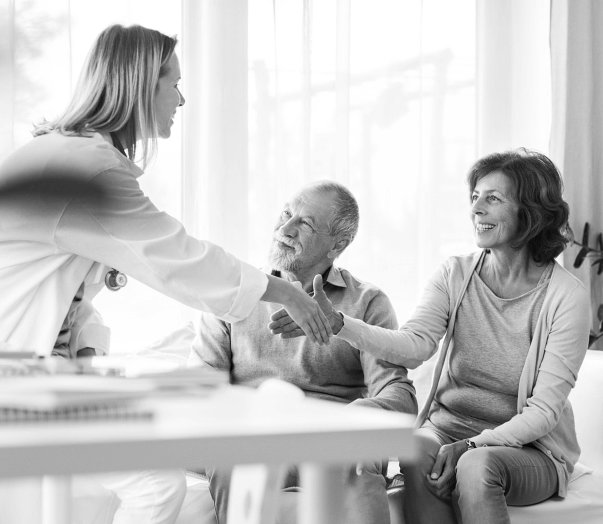 elderly couple having a nice talk to a doctor