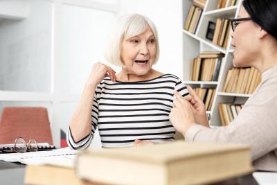 senior woman talking to a caregiver
