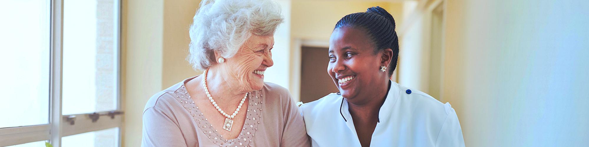 caregiver and a senior smiling
